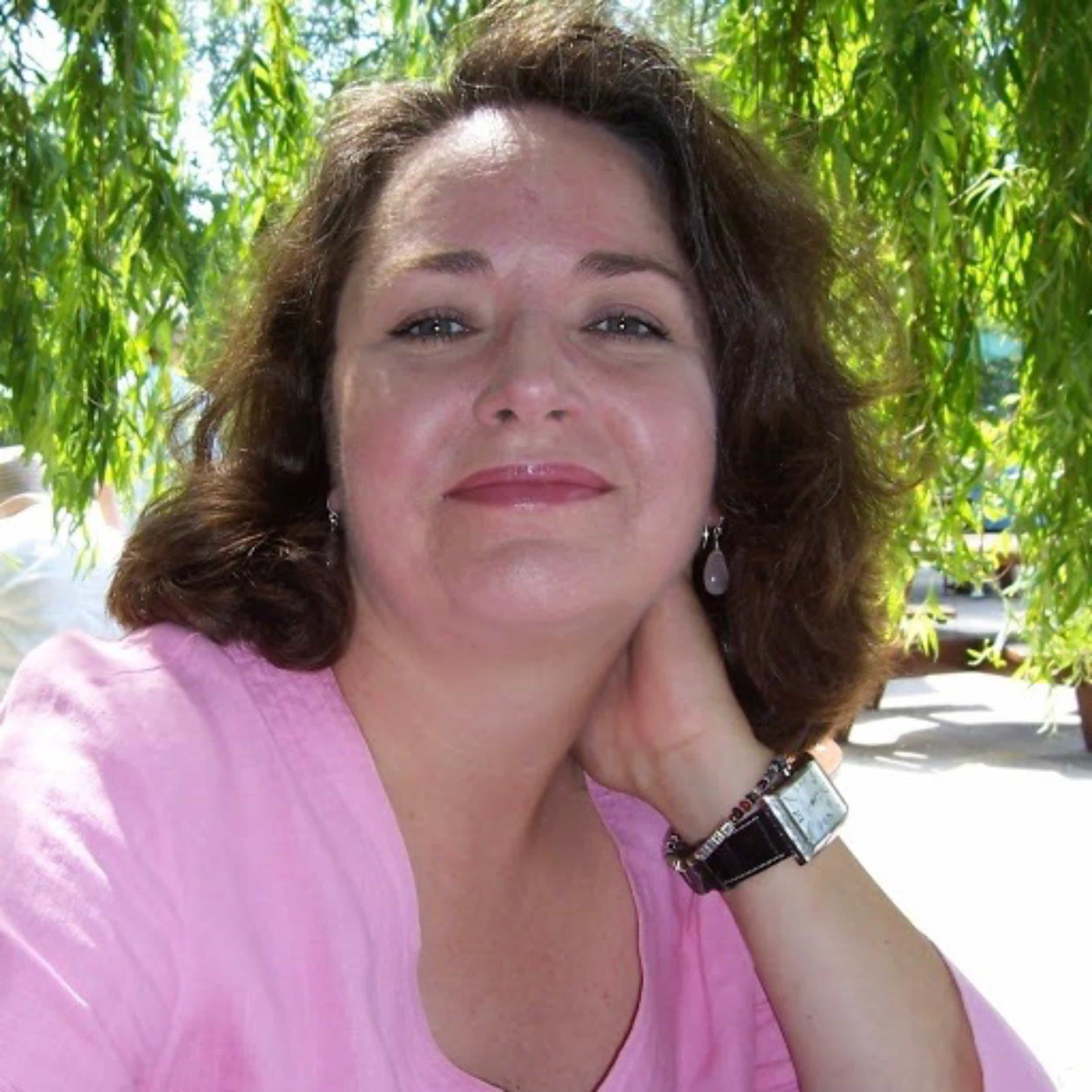 Woman in pink T Shirt smiling at the camera